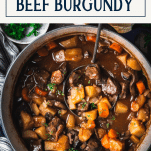 Overhead shot of a pot of beef burgundy with text title box at top