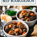 Side shot of bowls of beef burgundy with text title box at top