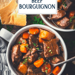 Close overhead shot of easy beef bourguignon on a table with text title overlay
