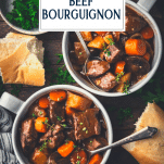 Overhead shot of two bowls of easy beef burgundy on a table with text title overlay