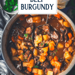 Overhead shot of a pot of beef burgundy with text title overlay
