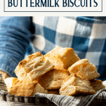 Hands holding a bowl of flaky biscuits with text title box at top