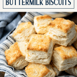 Close up shot of a basket full of flaky biscuits with text title box at top