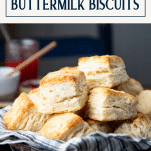 Bowl of homemade buttermilk biscuits with text title box at top