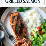 Close overhead image of a simple grilled salmon recipe served on a white plate with text title box at top