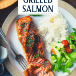 Overhead shot of grilled salmon on a plate with text title overlay