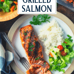 Overhead shot of a dinner plate with a grilled salmon fillet with text title overlay