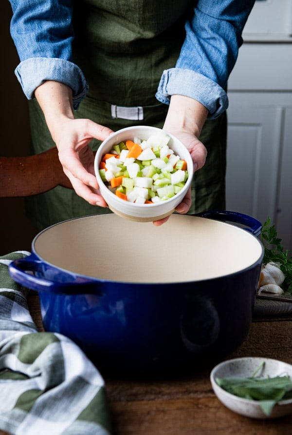 Adding carrots celery and onion to a Dutch oven
