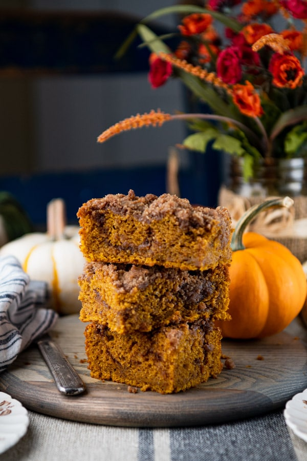 Three pieces of pumpkin coffee cake stacked on top of each other
