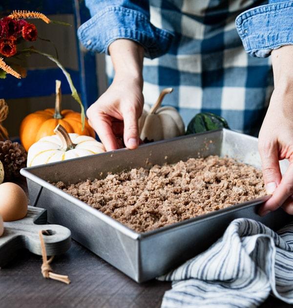 Process shot showing how to make pumpkin coffee cake recipe