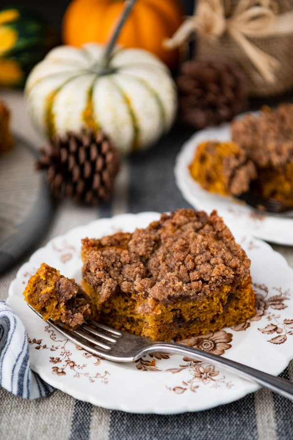 Close up side shot of a piece of easy pumpkin coffee cake on a small plate