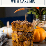 Squares of pumpkin spice coffee cake stacked with text title box at top