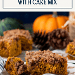 Side shot of pumpkin coffee cake on a table with text title box at top
