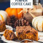 Side shot of pumpkin streusel coffee cake on a plate with text title overlay