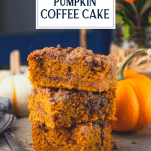 Stack of pumpkin coffee cake squares with text title overlay