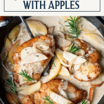 Skillet chicken in a pan with apples and text title box at top