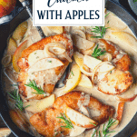 Overhead shot of creamy chicken with apples in a cast iron skillet with text title overlay