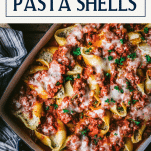 Overhead shot of beef stuffed shells with text title box at top