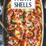 Serving spoon in a pan of easy stuffed pasta shells with text title overlay
