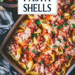 Overhead shot of a pan of ricotta stuffed shells with meat and text title overlay