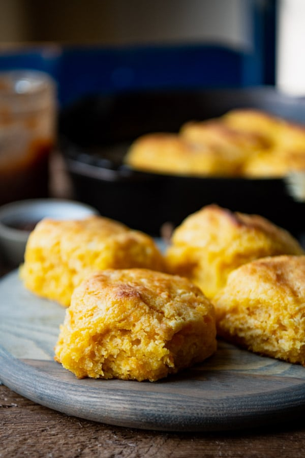 Flaky southern sweet potato biscuits on a wooden serving board