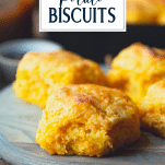 Close up side shot of old fashioned sweet potato biscuits with text title overlay