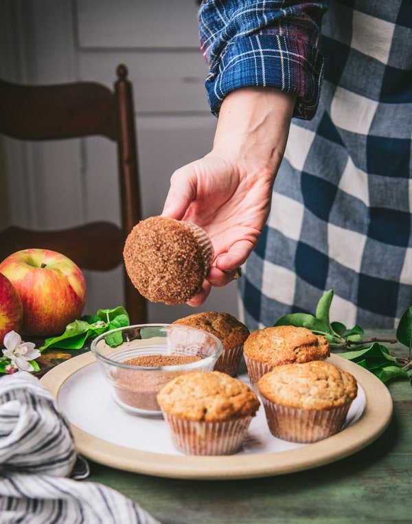 Dipping muffins in cinnamon sugar topping
