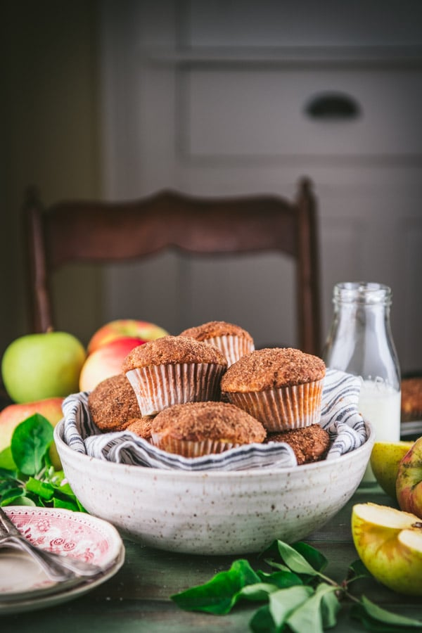 Side shot of apple spice muffins on a table