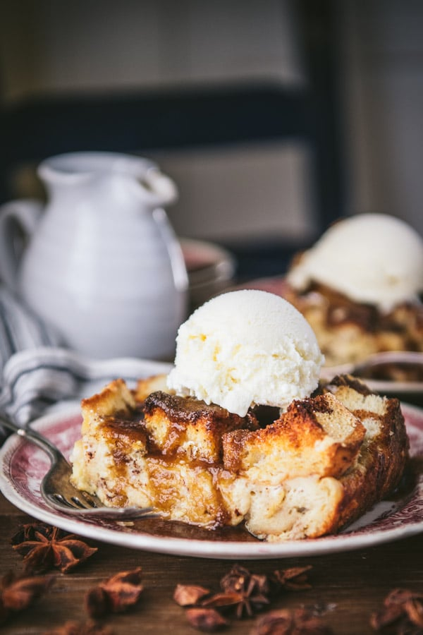Close up side shot of old fashioned bread pudding recipe on a wooden table