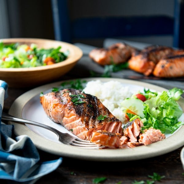 Square shot of the best grilled salmon recipe served on a dinner plate