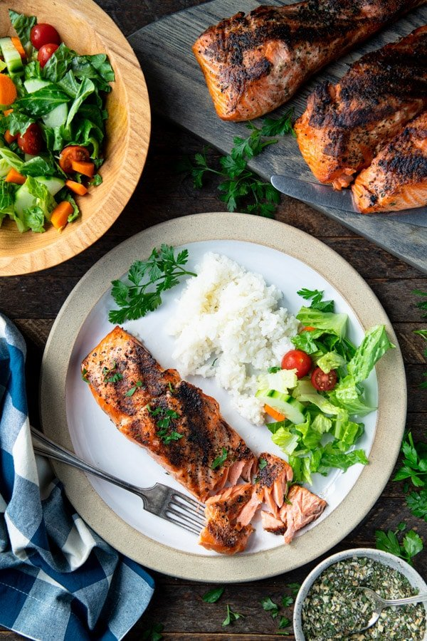 Overhead image of grilled salmon on a dinner table