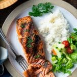 Overhead shot of the perfect grilled salmon recipe on a white plate