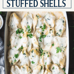 Close overhead shot of chicken stuffed shells with text title box at top