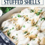 Close up side shot of chicken stuffed shells with text title box at top