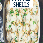 Close overhead shot of a pan of chicken stuffed shells with text title overlay