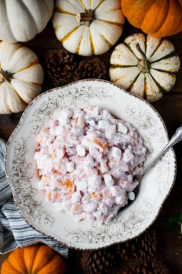 Overhead image of 5 minute cranberry fluff salad in a white serving bowl