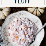 Overhead image of a bowl of cranberry fluff with text title box at top