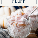 Close up side shot of glass bowls of cranberry fluff salad recipe with text title box at top