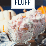 Side shot of cranberry fluff recipe served in glass bowls with text title overlay
