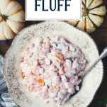 Overhead shot of cranberry fluff salad with text title overlay