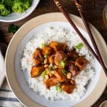 Close overhead shot of healthy general tso chicken recipe served in a bowl with rice and broccoli