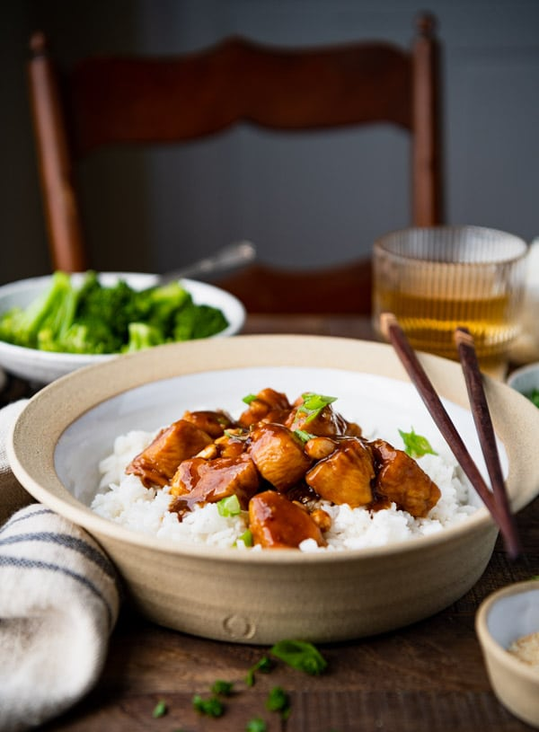Side shot of a bowl of homemade General Tso Chicken with rice