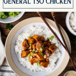 Overhead shot of healthy general tso chicken served with rice and broccoli and a text title box at the top