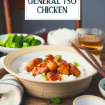 Side shot of a bowl of rice and healthy general tso chicken with text title overlay