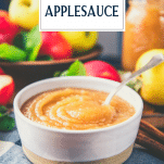 Side shot of a bowl of homemade applesauce with text title overlay