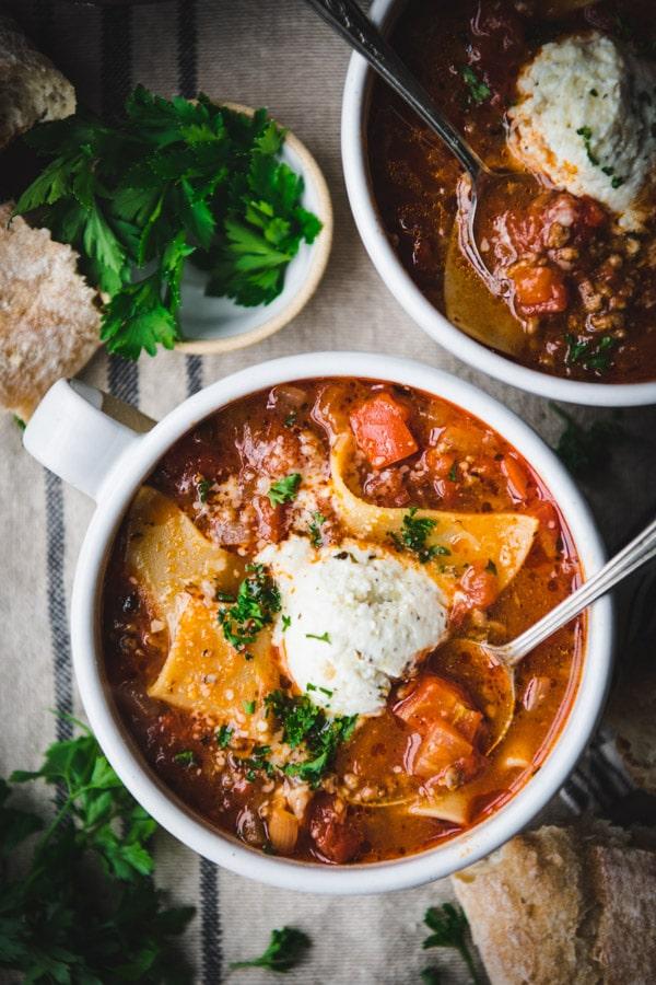 Close overhead image of a bowl of lasagna soup