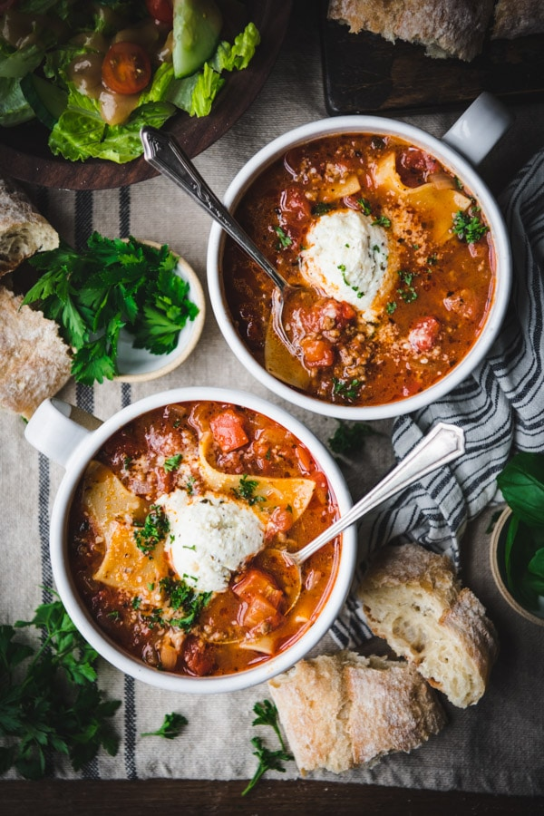Overhead shot of two bowls of easy lasagna soup recipe on a table