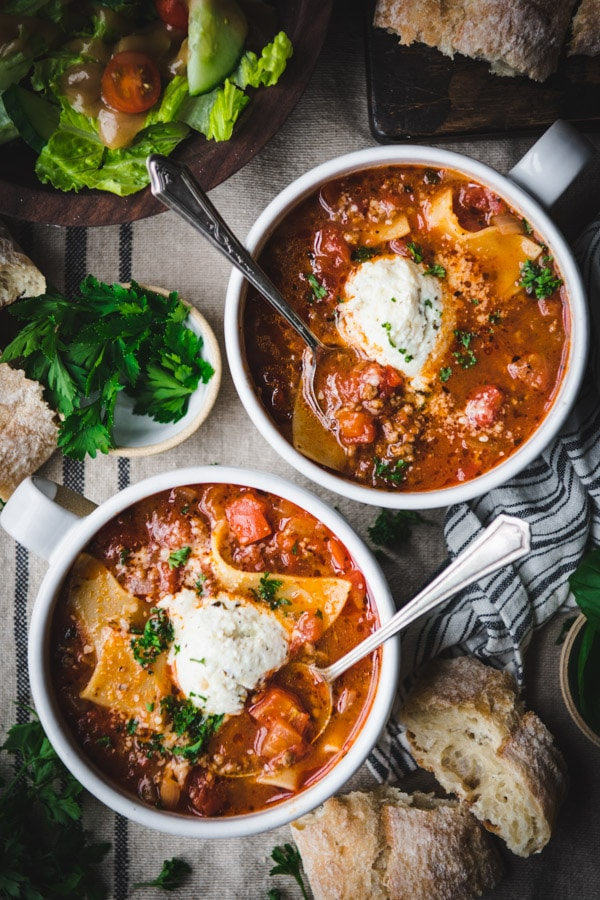 Overhead shot of two bowls of slow cooker lasagna soup