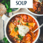 Overhead shot of a bowl of easy lasagna soup recipe in a bowl with text title overlay