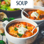 Side shot of spoons in bowls of lasagna soup with text title overlay